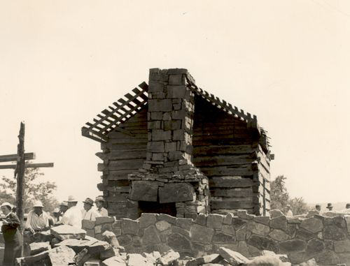 Building a protective structure around the cabin, ca. 1936 (Oklahoma Historical Society Photograph Collection) Courtesy of the Oklahoma Historical Society